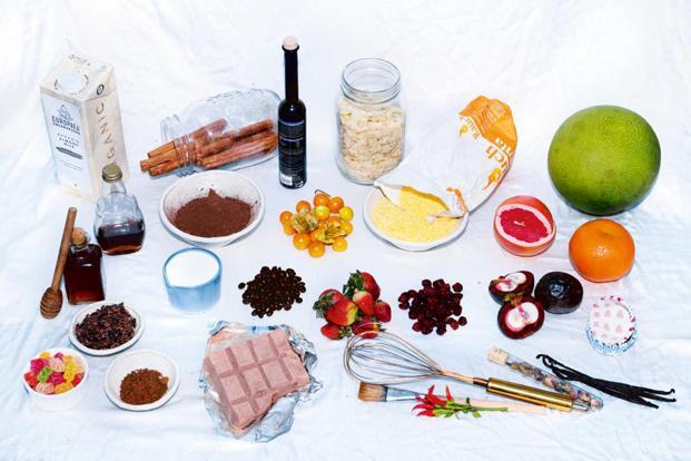 1. Europaea almond milk; 2. cinnamon; 3. sprig lavender extract; 4. almond flakes; 5. polenta flour; 6. pomelo, grape-fruit and orange; 7. vanilla beans; 8. red chillies; 9. single-origin chocolate by Regal; 10. gummy bears; 11. cocoa nibs and coconut palm sugar; 12. honey and maple syrup;  13. cream; 14. fresh and dried berries; 15. mangosteen. Photo: Pradeep Gaur/Mint