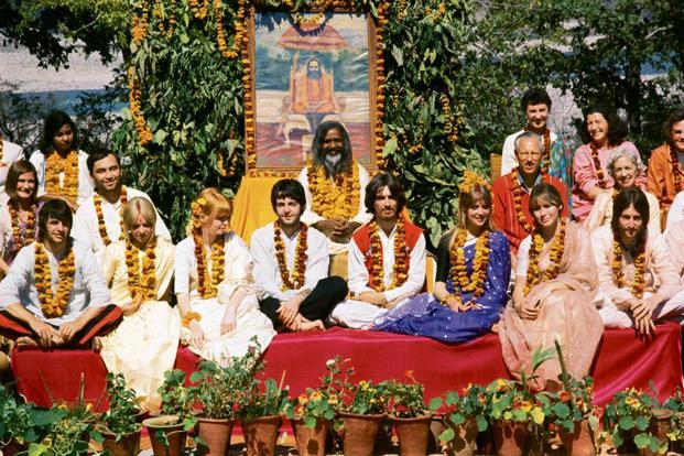 Maharishi Mahesh Yogi and participants of a meditation course pose for a photograph, in February 1968. Photo: Paul Saltzman
