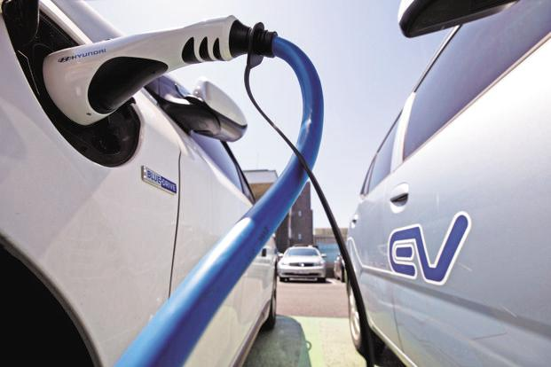 Representational image. A charging plug sits connected to an electric vehicle (EV) at a charging station in South Korea on June 15, 2017. Photo: Bloomberg