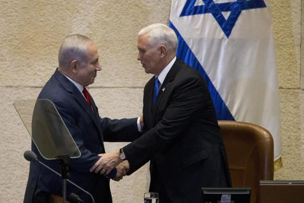 Israel's Prime Minister Benjamin Netanyahu (left) shake hands with US vice president Mike Pence in Israel's parliament in Jerusalem on Monday. Photo: AP