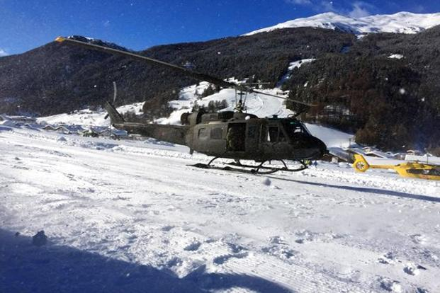 An Italian army helicopter lands during the evacuation of guests and tourists of Langtauferer hotel in the Venosta valley, Italy, on Tuesday. Photo: AP