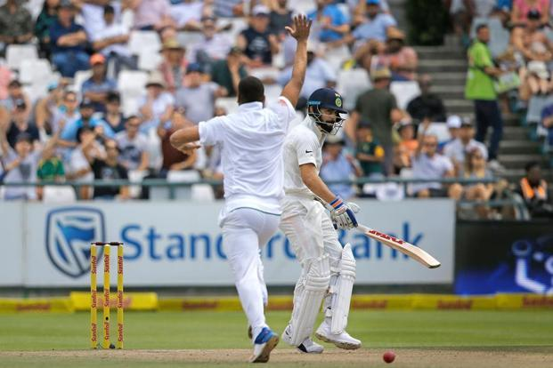 Vernon Philander (left) of South Africa celebrates the dismissal of India's Virat Kohli during the fourth day of the first Test match at Newlands, Cape Town, on 8 January. Photo: Marco Longari/AFP