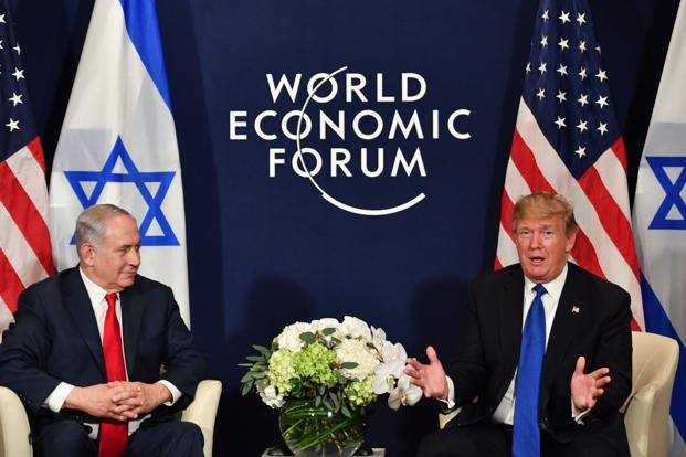 Donald Trump speaking after a meeting with Israeli Prime Minister Benjamin Netanyahu at the World Economic Forum, said he wanted peace. Photo: AFP