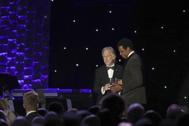 Jay-Z, right, accepts his award from Recording Academy president Neil Portnow at the 2018 pre-Grammy gala in New York on 27 January. Photo: AP