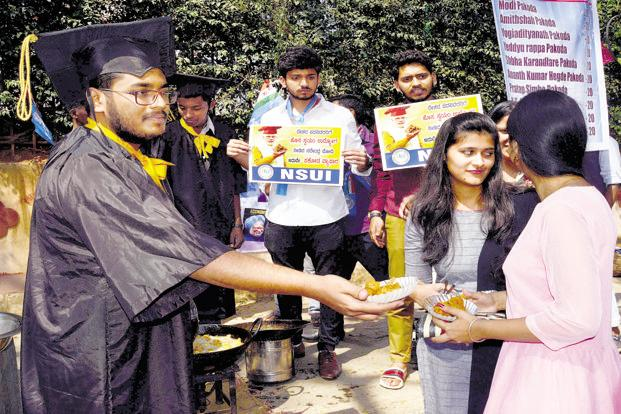 NSUI members selling pakoras in Bengaluru on Tuesday. Photo: PTI