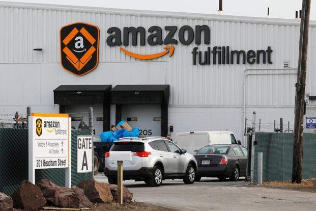 Amazon shares rose as much as 6.8% in extended trading after closing at $1,390 in New York. Photo: Reuters