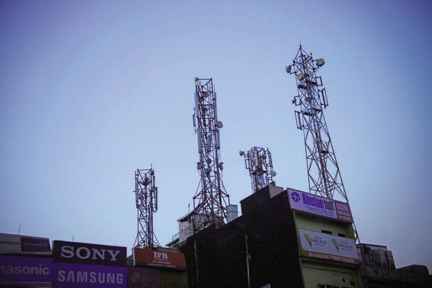 Telecom operators are liable to pay around 3-5% and 8% of adjusted gross revenue as spectrum usage charges and licence fees, respectively, to DoT. Photo: Pradeep Gaur