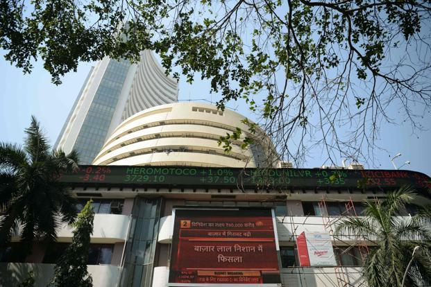 Equities close in red, Sensex recovers over 700 points