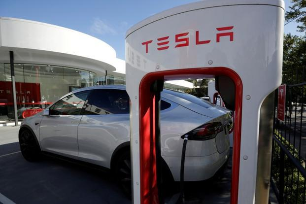 Billionaire Elon Musk last year built the world's biggest lithium-ion battery system to support South Australia's blackout-plagued power grid. Photo: Reuters
