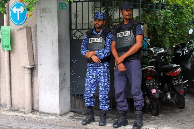 Maldivian police officers stand guard on a street after Maldives President Abdulla Yameen declared a state of emergency for 15 days, in Male, on 6 February. Photo: Reuters