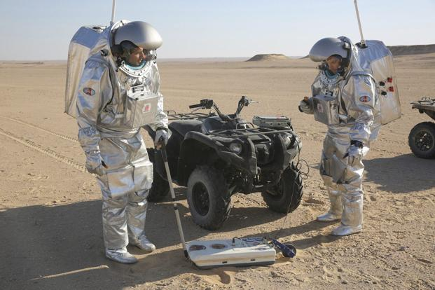 In this 7 February, 2018, photo, two scientists test space suits and a geo-radar for use in a future Mars mission in the Dhofar desert of southern Oman. Photo: AP