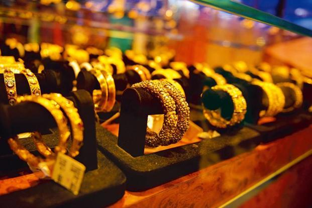 Globally, gold fell 0.20% to $1,315.70 an ounce and silver by 0.37% to $16.43 an ounce in New York in Friday's trade. Photo: Pradeep Gaur/Mint