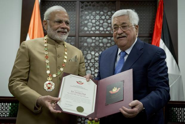 Palestinian President Mahmoud Abbas (right) decorates Prime Minister Narendra Modi with the Grand Collar of the State of Palestine medal, during his visit on Saturday. Photo: AP