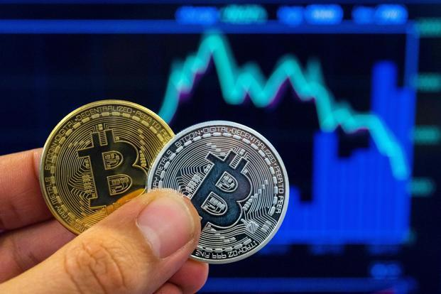 While the market turmoil can usually be found in bitcoin prices and headlines, this week US equities are beating the largest cryptocurrency on that field. Photo: AFP