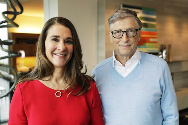 Microsoft co-founder Bill Gates and his wife Melinda. Bill said Donald Trump's tax overhaul mostly benefits corporations. Photo: AP