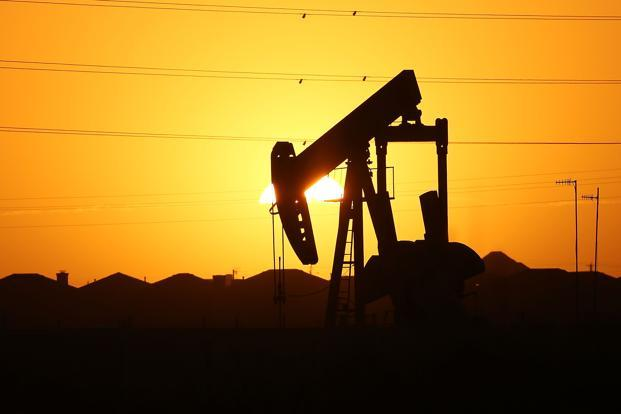 Oil prices flat on oversupply concerns, weak dollar