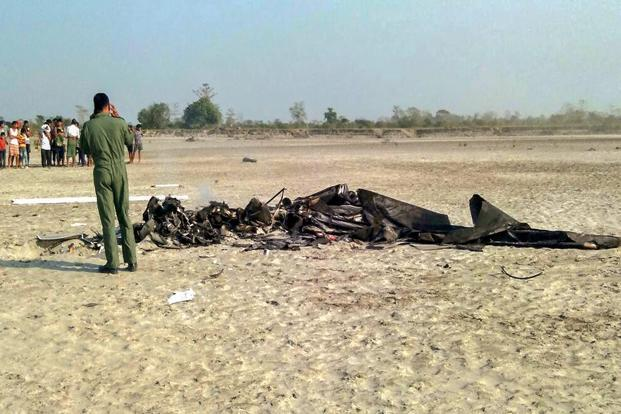 An Air Force official inspects the wreckage of a microlight helicopter that crashed with two pilots on board, at Majuli, Assam, on Thursday. Photo: PTI