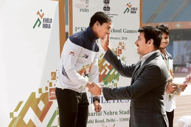 Ahmad receiving his gold medal from sports minister Rajyavardhan Singh Rathore during the Khelo India School Games. Photo: Sanjay Gupta