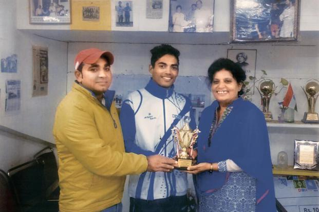 A file photo of Ahmad with his teacher Surender Singh and coach Sunita Rai. Courtesy: Sunita Rai
