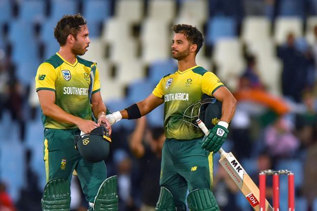 South Africa's Farhaan Behardien, left, and captain Jean-Paul Duminy celebrate after winning the second T20 International cricket match between South Africa and India on Wednesday. Photo: AFP