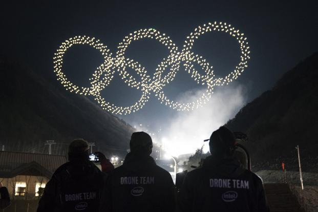 The cold and windy night sky of PyeongChang was dotted with 1,218 drones as they created history with the first-ever drone light show at the Winter Olympics. Photo: Intel