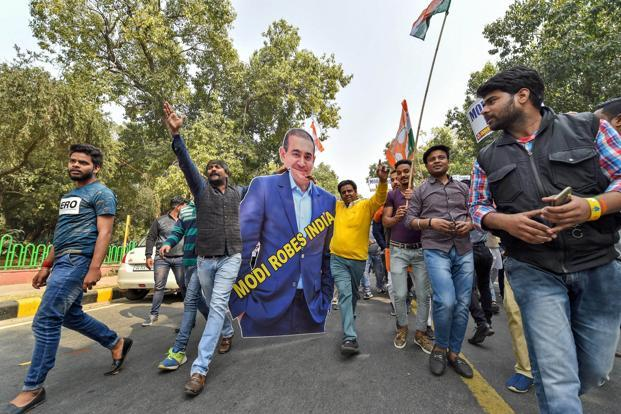 A file photo of protests against the PNB fraud in New Delhi. PNB's Thursday communique was in response to a letter written by Nirav Modi on Monday in which he had accused the bank of jeopardizing his ability to repay dues. Photo: PTI