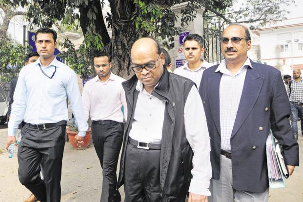 Rotomac group owner Vikram Kothari and his son Rahul (second from left) at the Patiala House Court in New Delhi on Friday. Photo: PTI