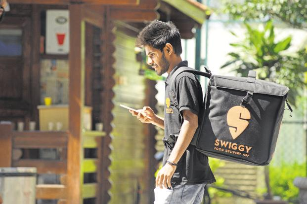 Bengaluru-based Swiggy leads the stack with a 35-38% market share, followed by Zomato at 25-30%, according to RedSeer. Photo: Hemant Mishra/Mint