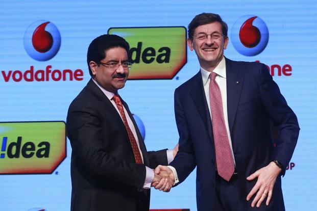 Vodafone CEO Vittorio Colao (R) shakes hand with Aditya Birla Group chairman, Kumar Mangalam Birla in Mumbai. Vodafone's Indian unit has announced a merger with Idea Cellular, creating the country's largest telecom operator. File photo: PTI