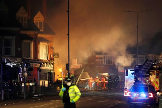 Members of the emergency services work at the site of an explosion which destroyed a convenience store and a home in Leicester, Britain, on Sunday. Photo: Reuters
