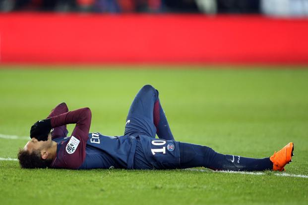 Neymar had to be stretchered off after an ankle injury against Marseille and is in danger of missing the Real Madrid Champions League clash. Photo: Reuters