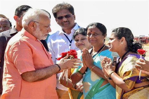 Prime Minister Narendra Modi with BJP workers at Hubballi airport, in Karnataka on Tuesday. Photo: PTI