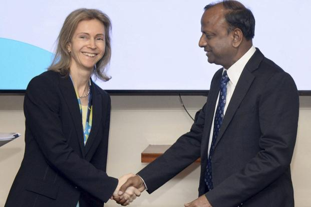 SBI chairman Rajnish Kumar with Google's Diana Layfield in Mumbai on Tuesday. The integration  with Google Tez will now allow SBI customers to transact directly from their bank accounts through the mobile payments app. Photo: PTI