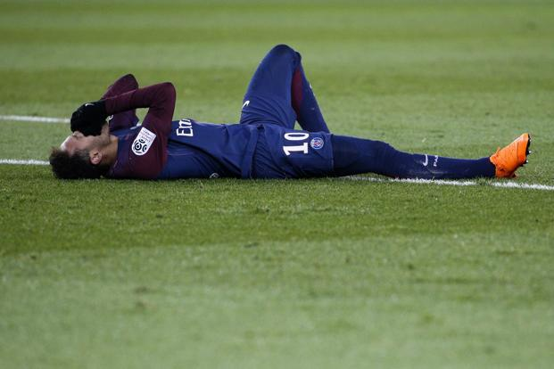 Neymar suffered a cracked metatarsal in his foot and a twisted ankle in an innocuous looking incident against Marseille on Sunday night. Photo: AFP