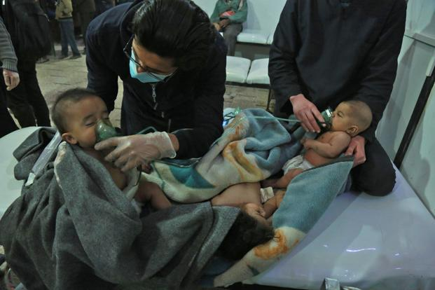 Syrian babies receive treatment for a suspected chemical attack at a makeshift clinic on the rebel-held village of al-Shifuniyah in the eastern Ghouta region, on 25 February. Photo: AFP