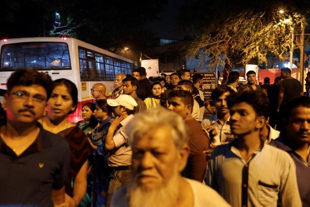 People gather outside an airport as they wait to see the ambulance carrying the body of Bollywood actress Sridevi in Mumbai. Photo: Reuters