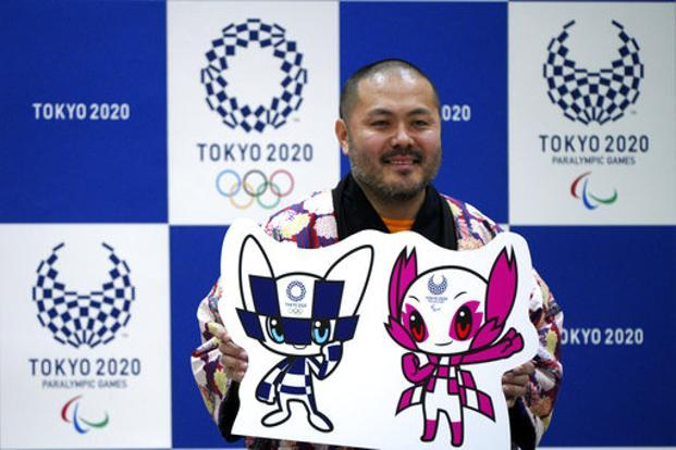 Ryo Taniguchi poses with his creation that will serve as mascots for the 2020 Tokyo Olympic and Paralympic games on 28 February