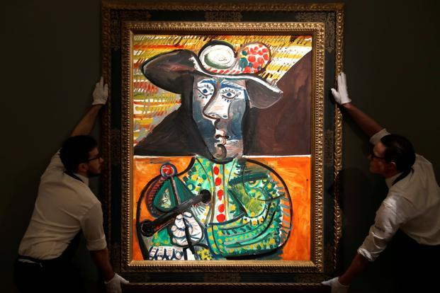 Sotheby's staff pose for a photograph with Pablo Picasso's Le Matador which is estimated at £14 to 18 million in a forthcoming sale, in London on 22 February. Photo: Reuters
