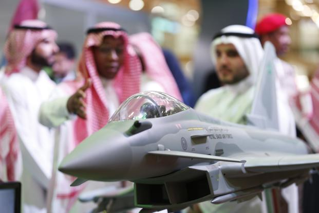 Visitors look at a display model of a Saudi Air Force Eurofighter Typhoon jet at an armed forces exhibition in Riyadh, on 27 February. Phot: Bloomberg