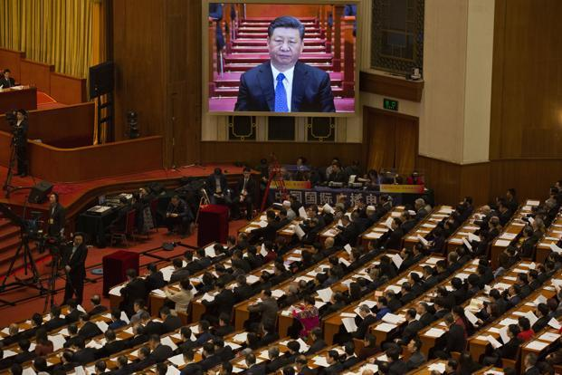 Chinese president Xi Jinping is seen on a large screen at the opening session of the Chinese People's Political Consultative Conference in Beijing's Great Hall of the People on Saturday. Photo: AP