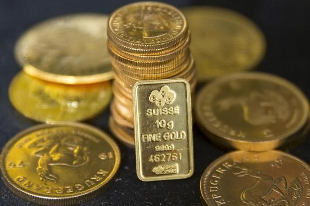 Spot gold rate rose 0.4% to $1,326.76 per ounce at 1.26pm. Photo: Reuters