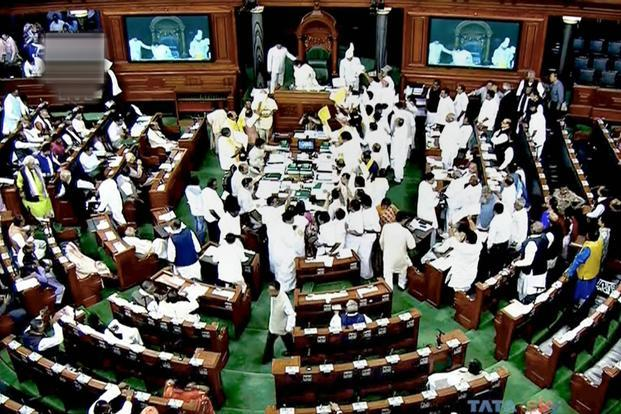 Opposition MPs entered the well of the house demanding a reply from Prime Minister Narendra Modi in Parliament. Photo: PTI