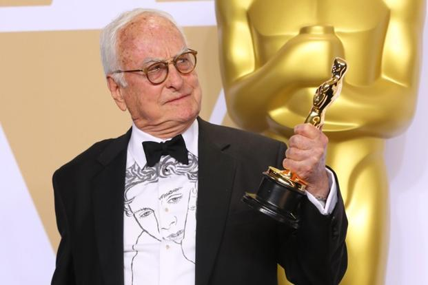 James Ivory holds his Oscar for best adapted screenplay for Call Me My Your Name in California on Sunday. Photo: Reuters