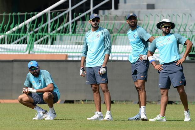 Indian cricket captain Rohit Sharma, left, and teammates during a training session at the R. Premadasa Stadium in Colombo on Monday. Photo: AFP