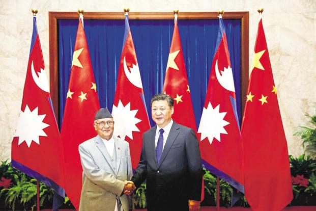 Chinese President Xi Jinping (R) with Nepal Prime Minister Khadga Prasad Sharma Oli (L) inside the Great Hall of the People in Beijing, on 21 March 2016. Photo: Reuters