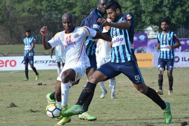 Dudu Omagbemi of East Bengal (in white) in action against Minerva Punjab during an I-League match in February. Photo: HT