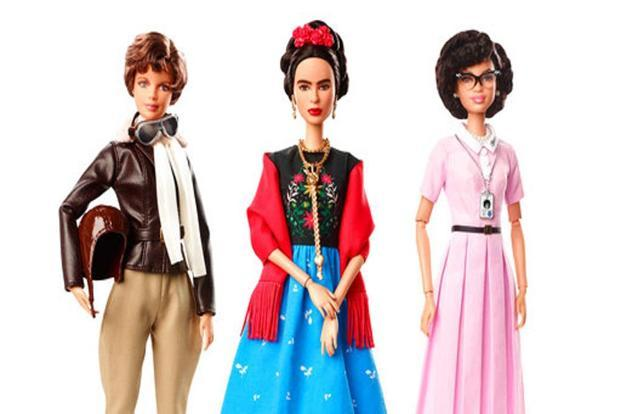Amelia Earhart (left), Mexican artist Frida Kahlo (centre), and mathematician Katherine Johnson, part of the 'Inspiring Women' Barbie doll line from Mattel. Photo: AP