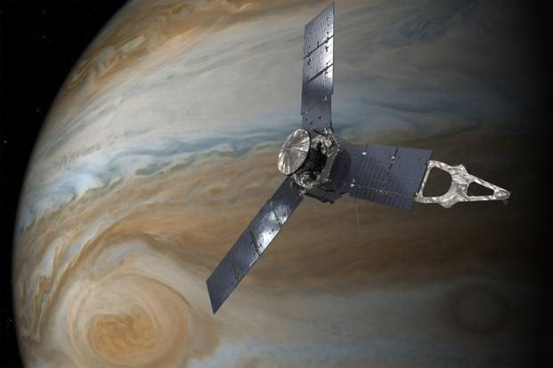 An illustration depicting Nasa's Juno spacecraft in orbit above Jupiter's Great Red Spot. Photo: Nasa/JPL-Caltech/Handout via Reuters
