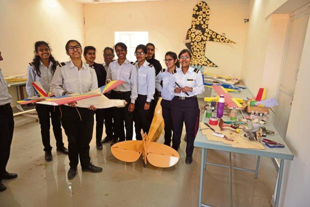 Aviation science students with a plane they made during aeromodelling classes.