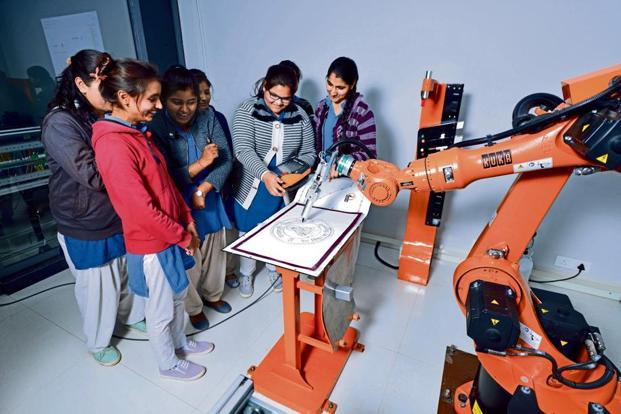 Students with the KUKA KR-16 robot.